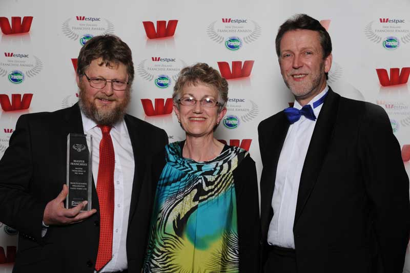 Mark and Mary-Anne Gilbert of Select Cleaning Wellington, with Simon Lord of Franchise New ZEaland magazine & website, sponsors of the Master Franchisee award