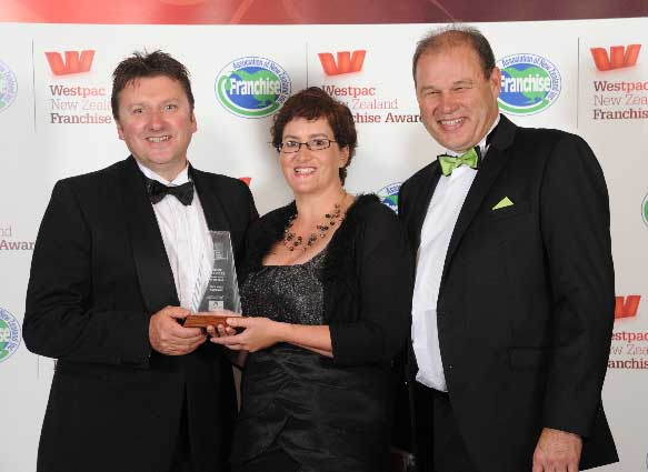 David and Prue Kimber with (right) Philip Morrison of sponsors Franchise Accountants