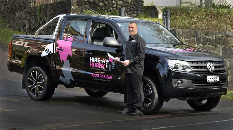 Hire a Hubby franchisee Shaun Penprase models the new look for the brand, which has been introduced as the company builds its commercial client base.