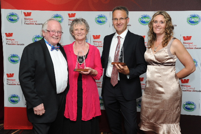 Business Services Franchisees of the Year Bruce and Sara Mildon (right) with Paramount founders Galvin and Suzanne Bartlett