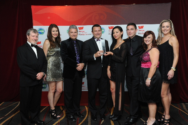 Rory Macdonald (far left) of sponsors Macdonald Bailey Law with some of the team taking BurgerFuel to the world.