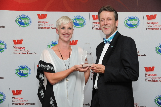 Courtenay Stefanek, of V.I.P. Home Services Mt Maunganui, pictured receiving her award from category sponsor Simon Lord of Franchise New Zealand magazine & website.