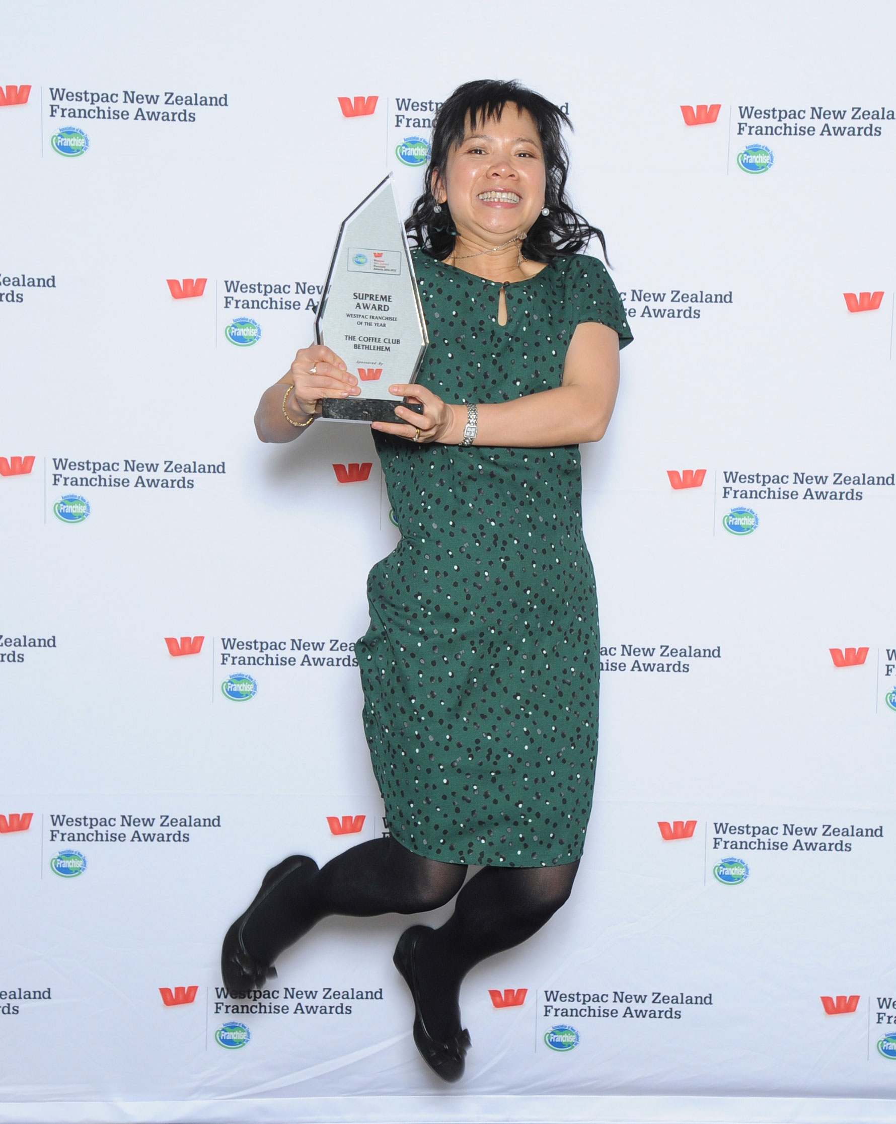 Jumping for joy! Triple Supreme Award-winner Ivy Joe with her favourite trophy
