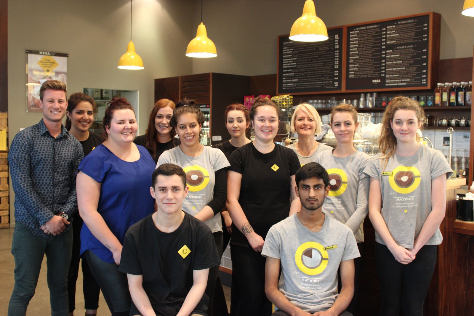 Korby Hall (left) with some of the family and team members who make up the award-winning team at Columbus Coffee in the Mitre 10 MEGA at Kapiti