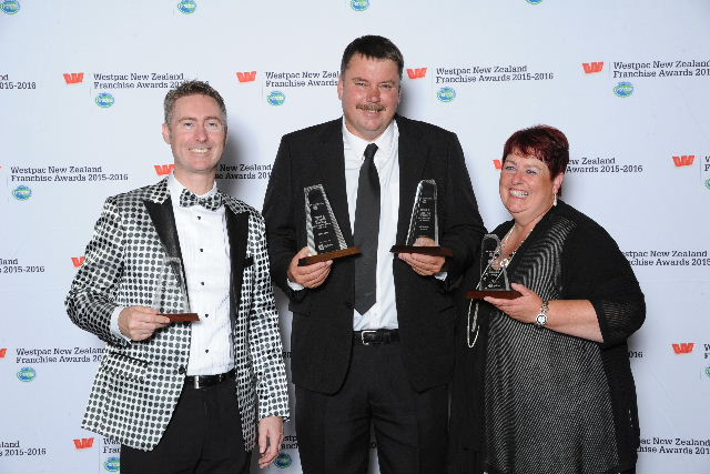 Just Cabins took both awards in the Lifestyle Services category. Franchisor Fenton Peterken (left) with Craig and Karen Nuttall