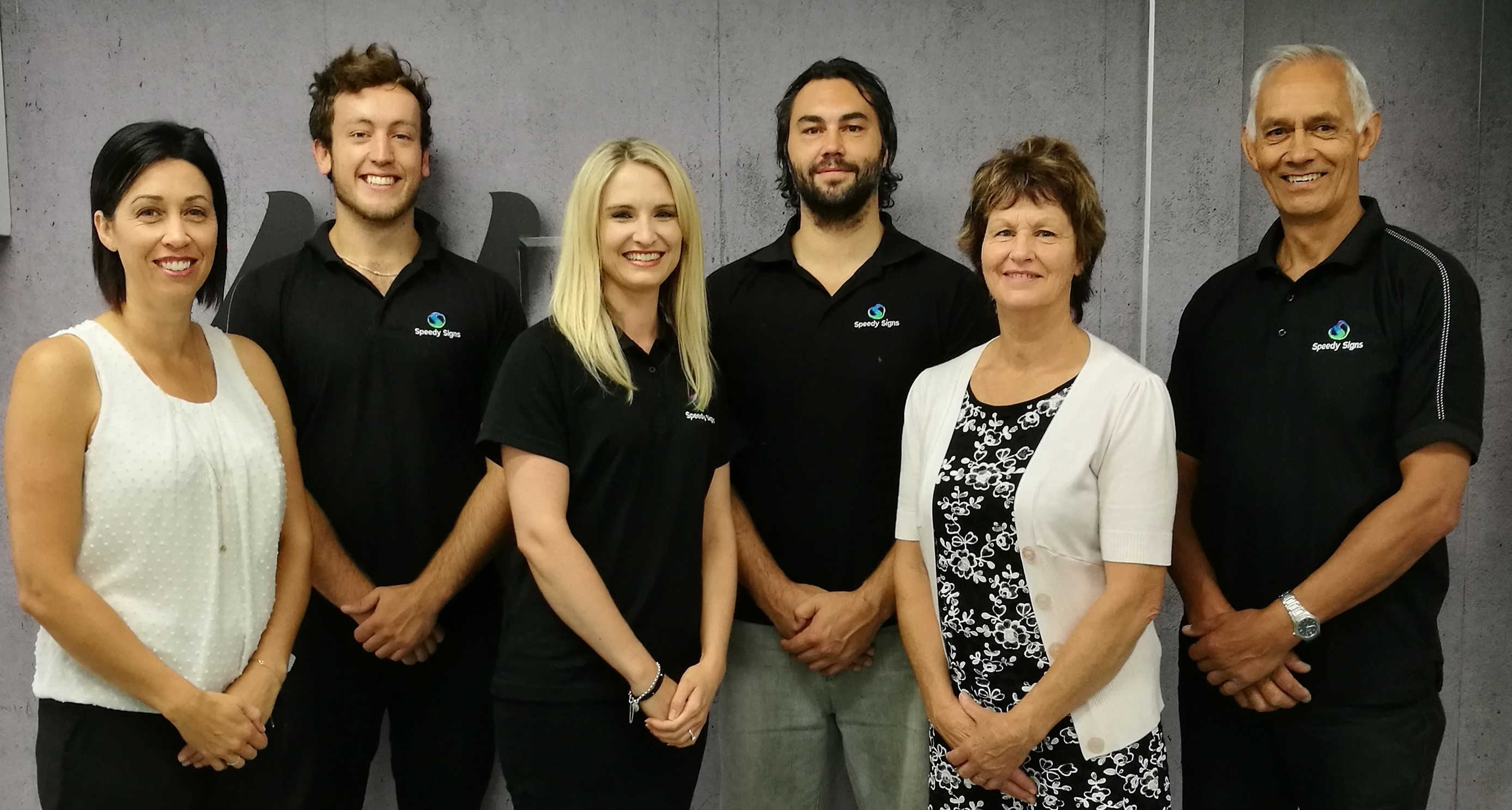 Business Services – Best Franchisee: Kevin and Sheryl Jones with their team (and family), Speedy Signs New Plymouth
